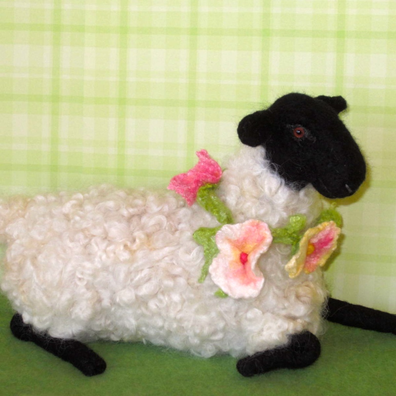 Reclining Suffolk Sheep, bedecked in beautiful blooms