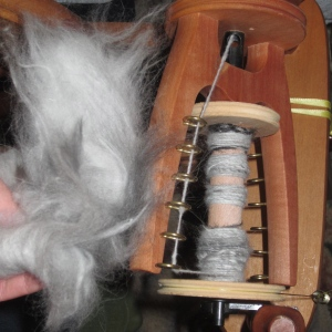 Apparently spinning Angora rabbit fur is exactly this easy!   Smart Deidra to have her wheel present for demonstration.