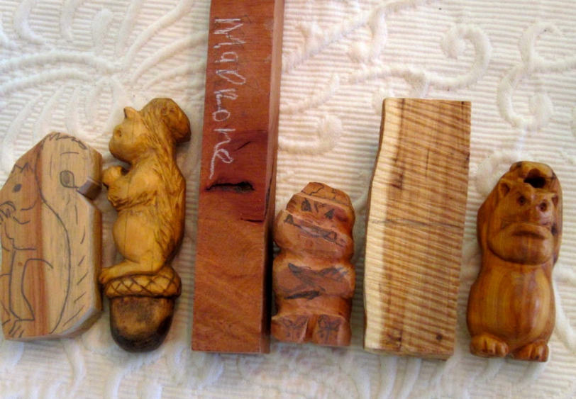 Carvings in progress.   A nearly complete SQUIRREL in Australian Cypress.  GREMLIN in madrone burl.  GREMLIN in yew.  Note the pale outer rim of the yew - so the Gremlins backside is pale too.